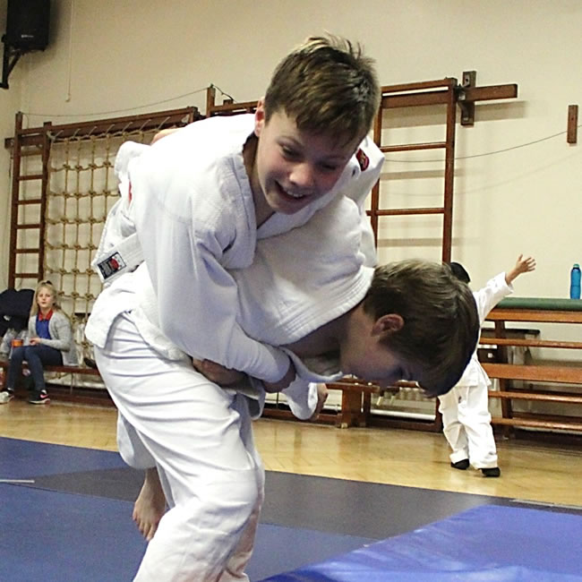 Boys having fun with judo throws at class in Elmbridge by Tora Kai School of Judo